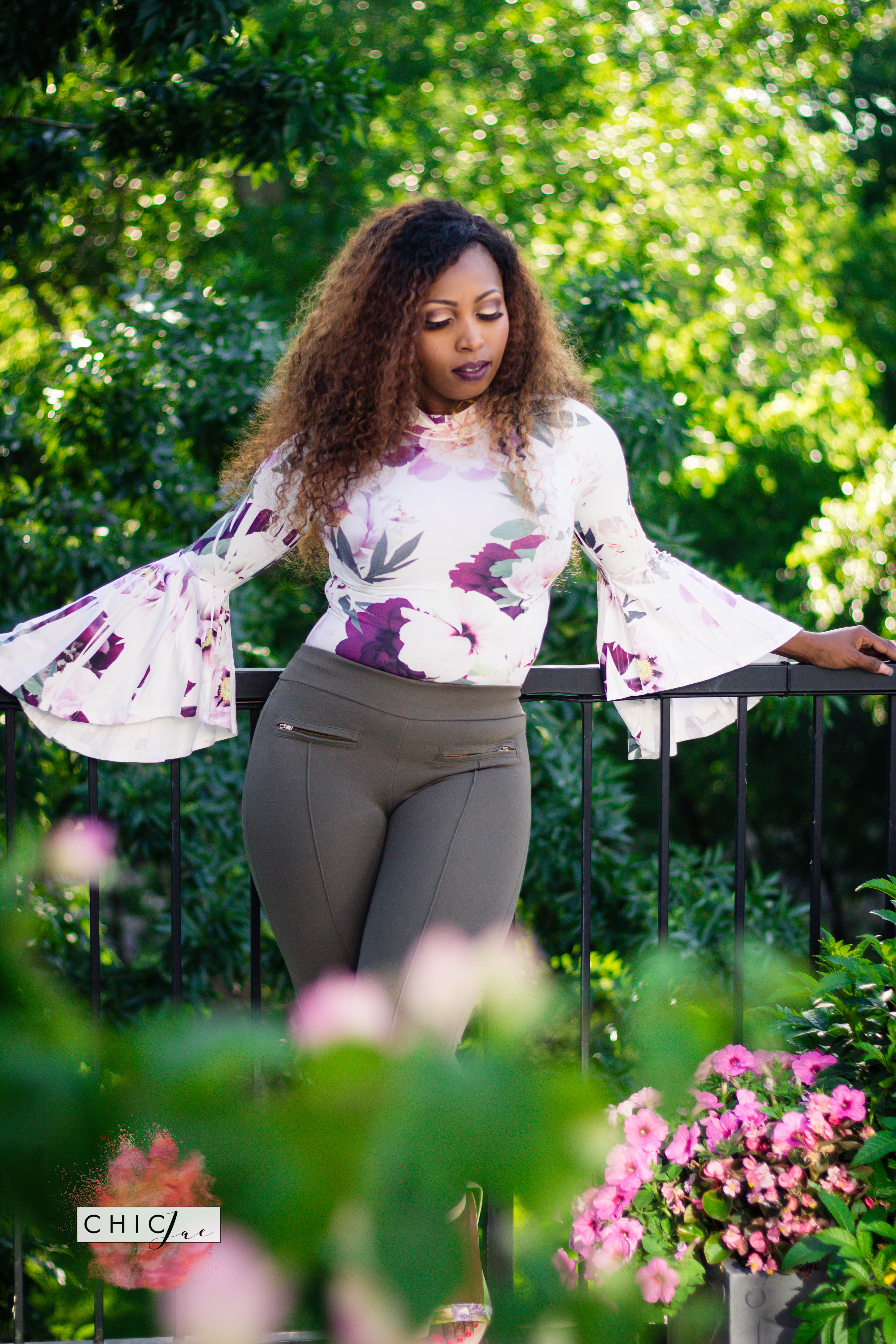 Brown Beauty in floral setting with floral outfit