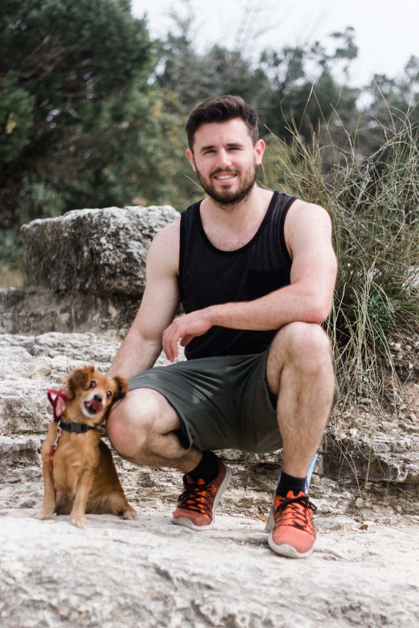 Man and small dog on Mt. Bonnell in Austin Texas